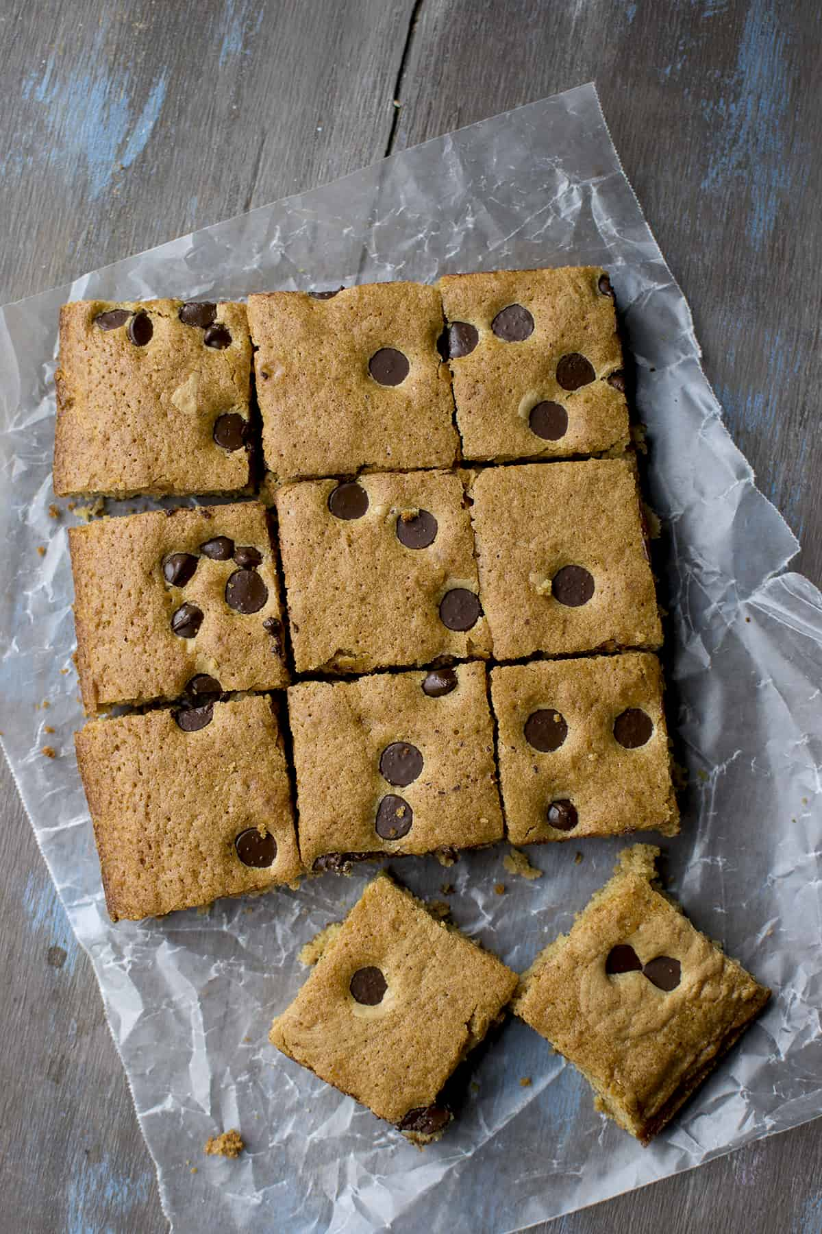 Parchment paper with chocolate chip topped blondies
