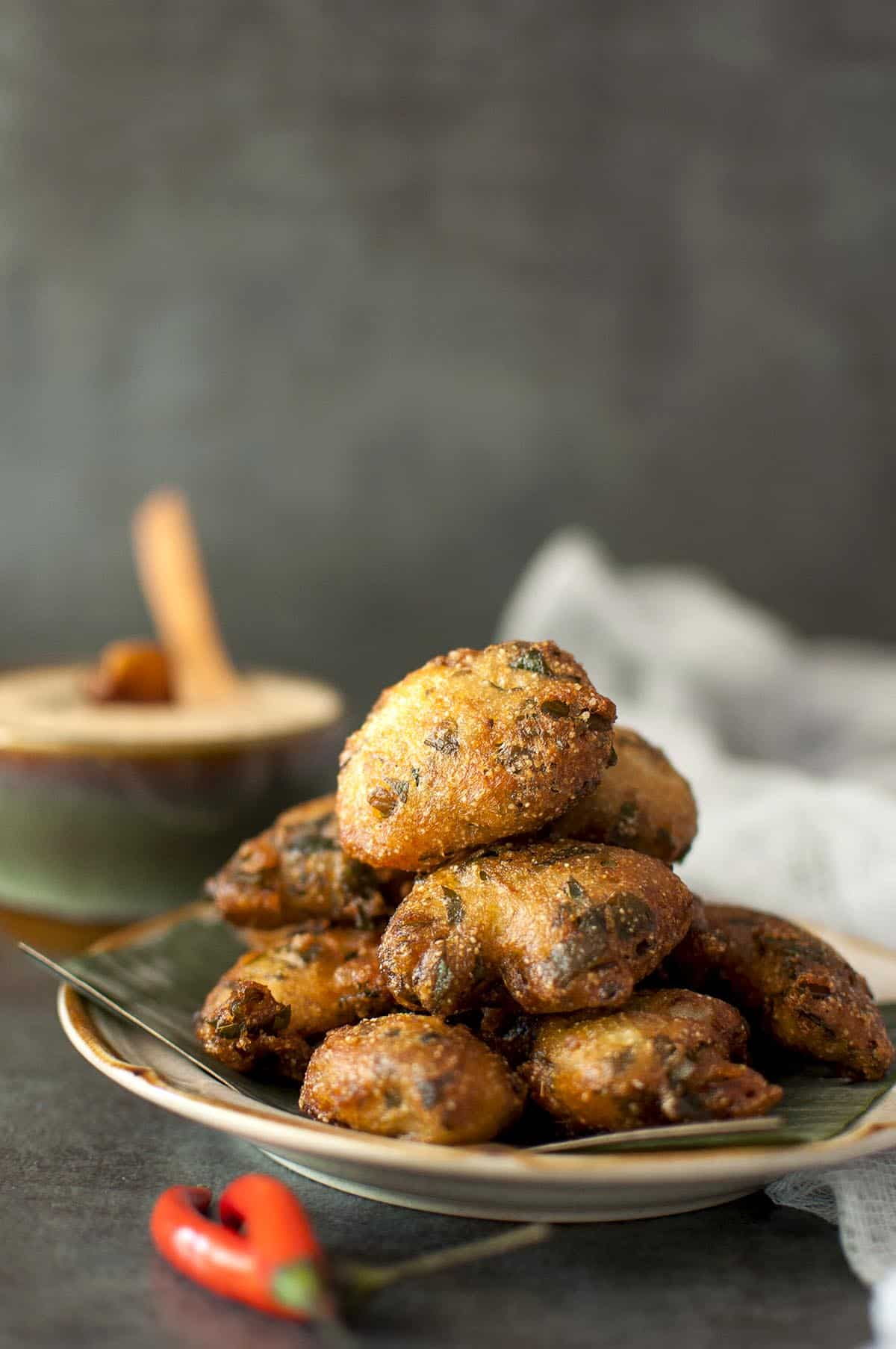 brown plate with crispy spinach fritters