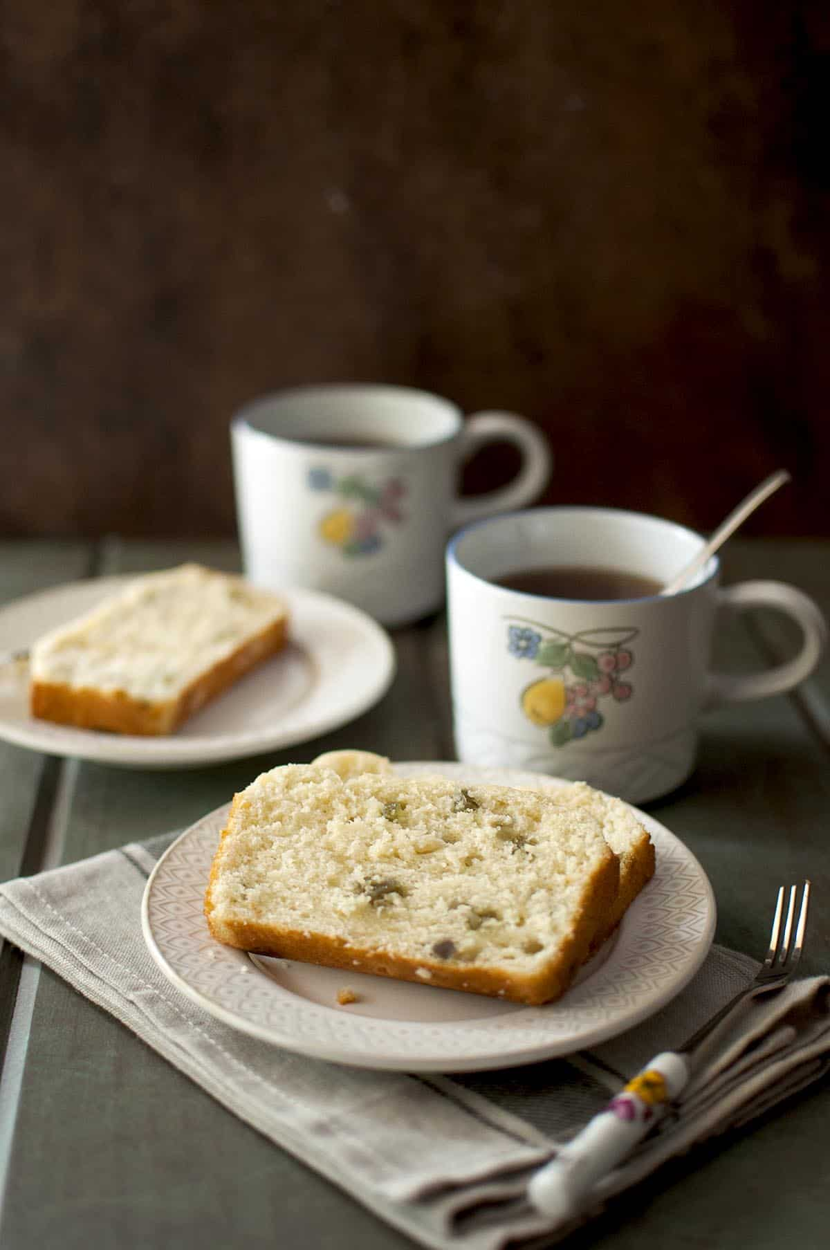 White plate with a slice of tea bread