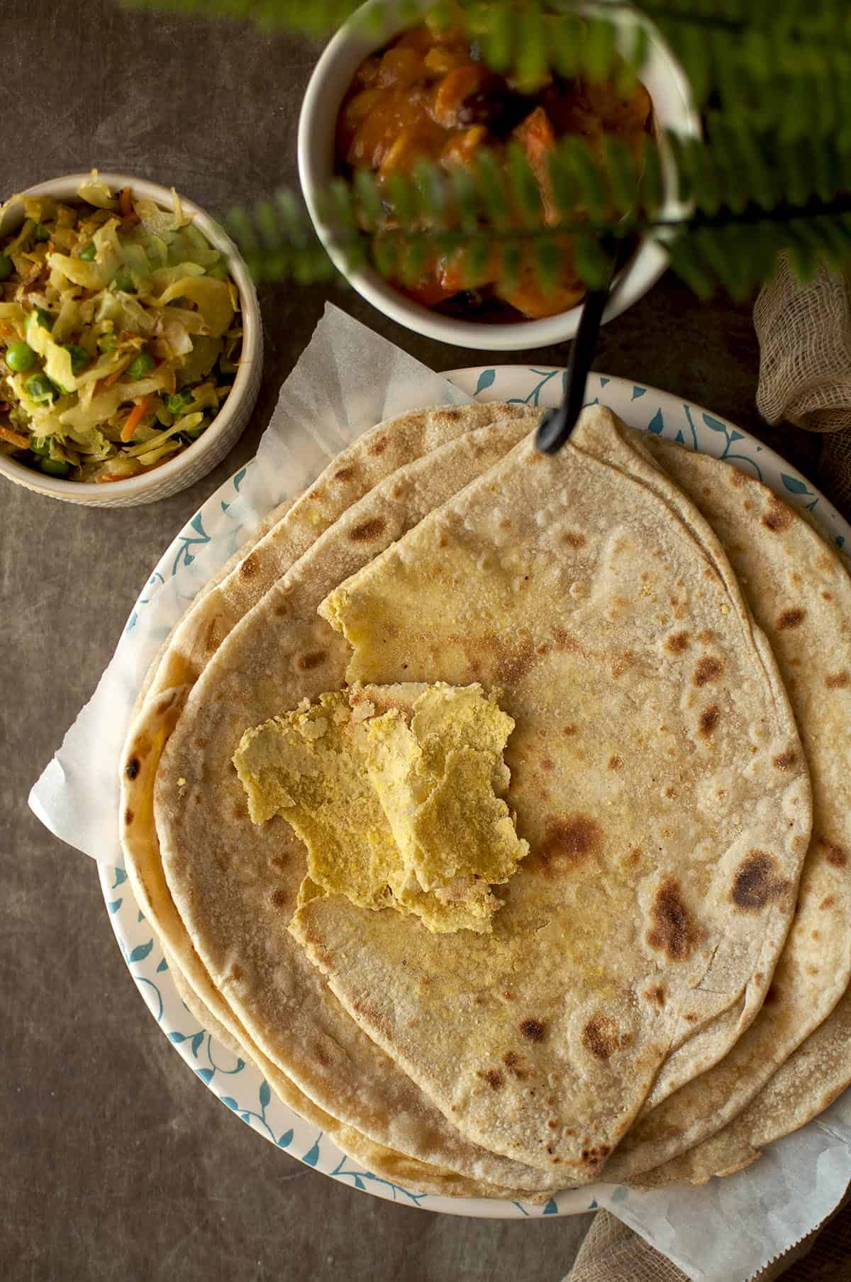 White plate with a stack of dal puri