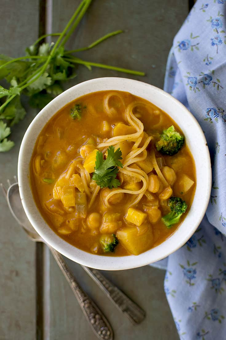 Bowl of Thai Curry soup with noodles and broccoli