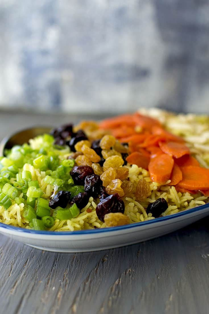 Plate of Holiday Jeweled Rice with dry fruit, scallions and carrots