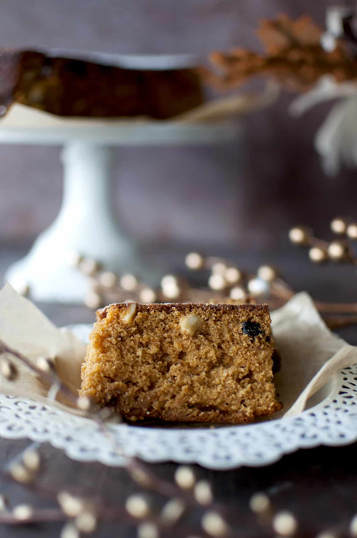 White plate with 2 slices of moist Kerala fruit cake