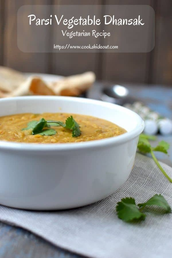 White bowl with Parsi style lentil and vegetable stew